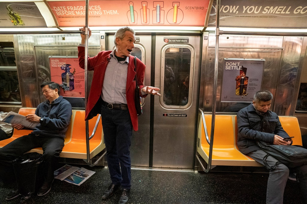Richard McLachlan, a member of Extinction Rebellion, the environmental action pressure group founded in Britain, delivers his message about climate change to commuters in the subway in New York. (Don Emmert, AFP)