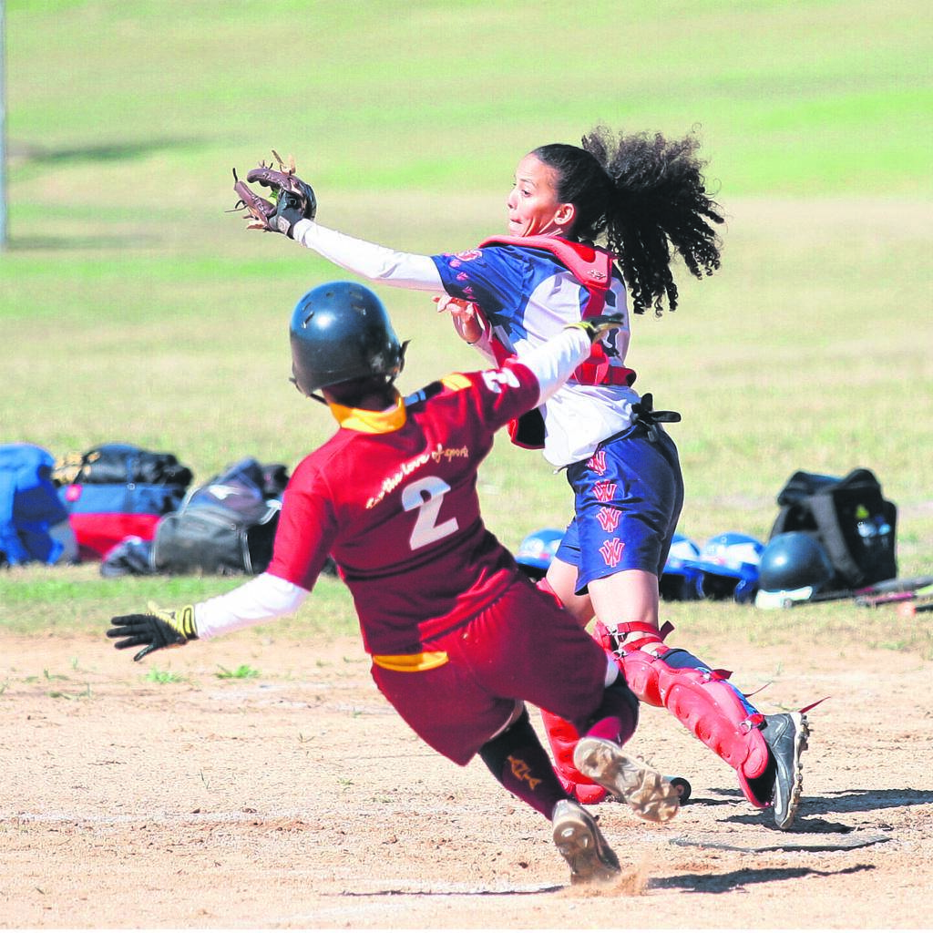 Jacky Adonis the Westridge Yankees catcher prepares to tag Tanta's Nawaal Nacerodien on home plate during a super league game played at Turfhall sport complex on Saturday 26 October.PHOTO: Rashied Isaacs
