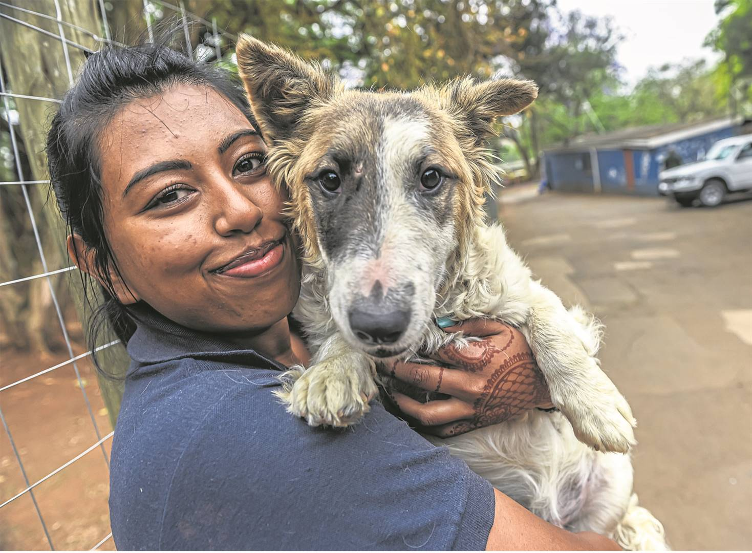 The SPCA's Diya Maharaj holds a stray Corgie cross Bull Terrier which the SPCA rescued during Diwali celebrations on Sunday night. PHOTO: Moeketsi Mamane