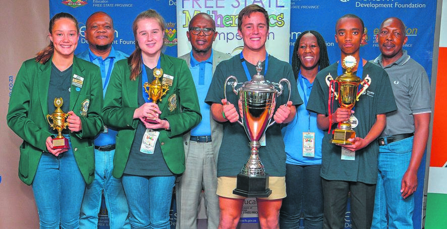 Top achievers of the 2019 Free State Mathematics Competition for Gr. 8 to Gr. 11 learners were announced after the final round at the Bon Hotel in Bloemfontein on 12 October. From the left are, front: Caitlin Rossouw, Lize Ferreira, Wian Botma (overall winner) and Amkitha Diko; back: Dr Tate Makgoe (MEC for Education), Cecil Ramonotsi (chief executive officer of the Eskom Development Foundation), Mandisa Tselane (Kagiso Trust Representative) and Michael Phutsisi (provincial partnerships manager). Photo: Supplied
