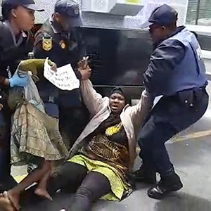 Hundreds of asylum seekers and refugees were removed from outside the UNHRC Cape Town offices following weeks of protests.