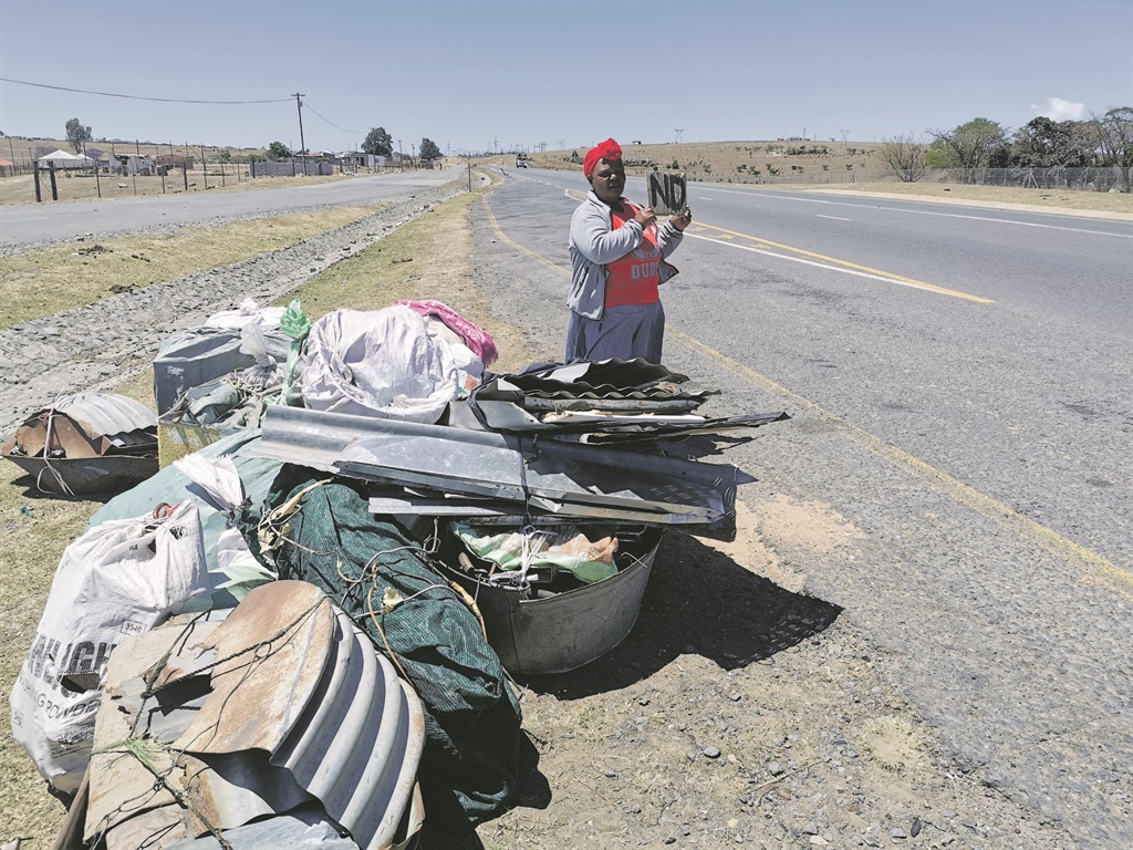 On the road, in a desperate attempt to earn a living, Vuyiswa Pikini collects scrap metal in Elliotdale and sells them in Durban. Picture: Lubabalo Ngcukana