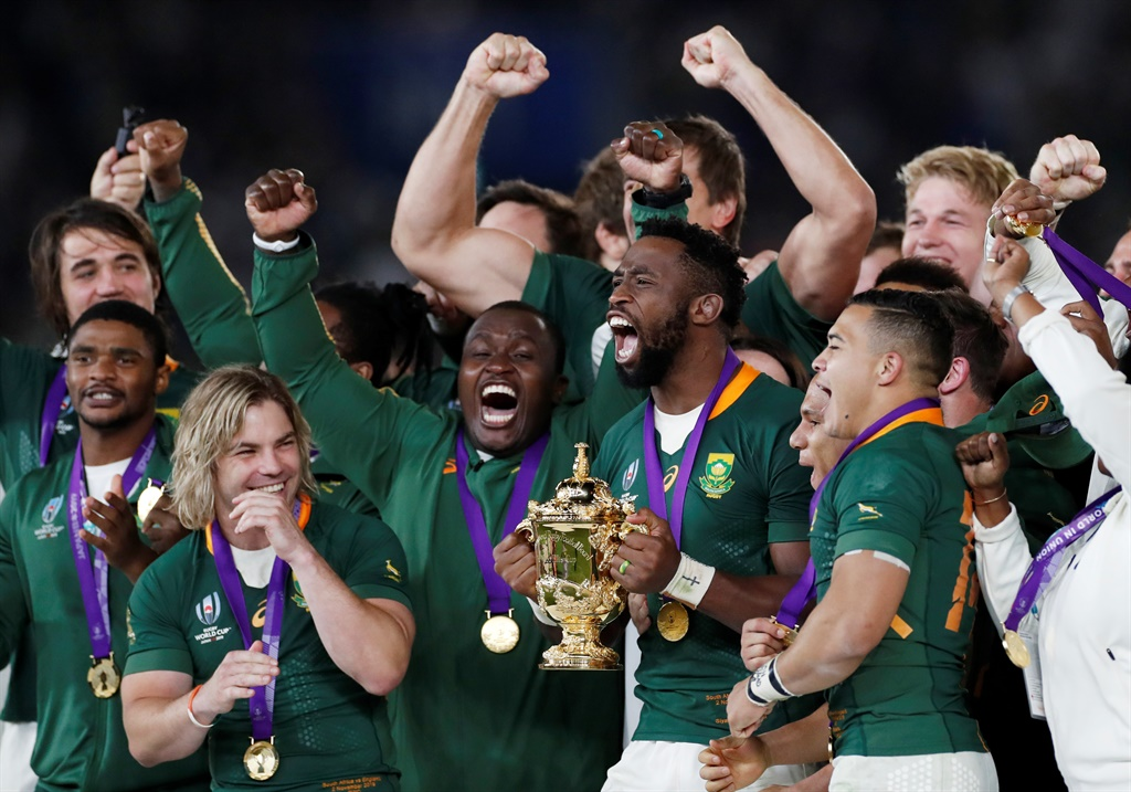 South Africa's Siya Kolisi celebrates with the Webb Ellis trophy and teammates after winning the World Cup Final. Picture: REUTERS/Peter Cziborra