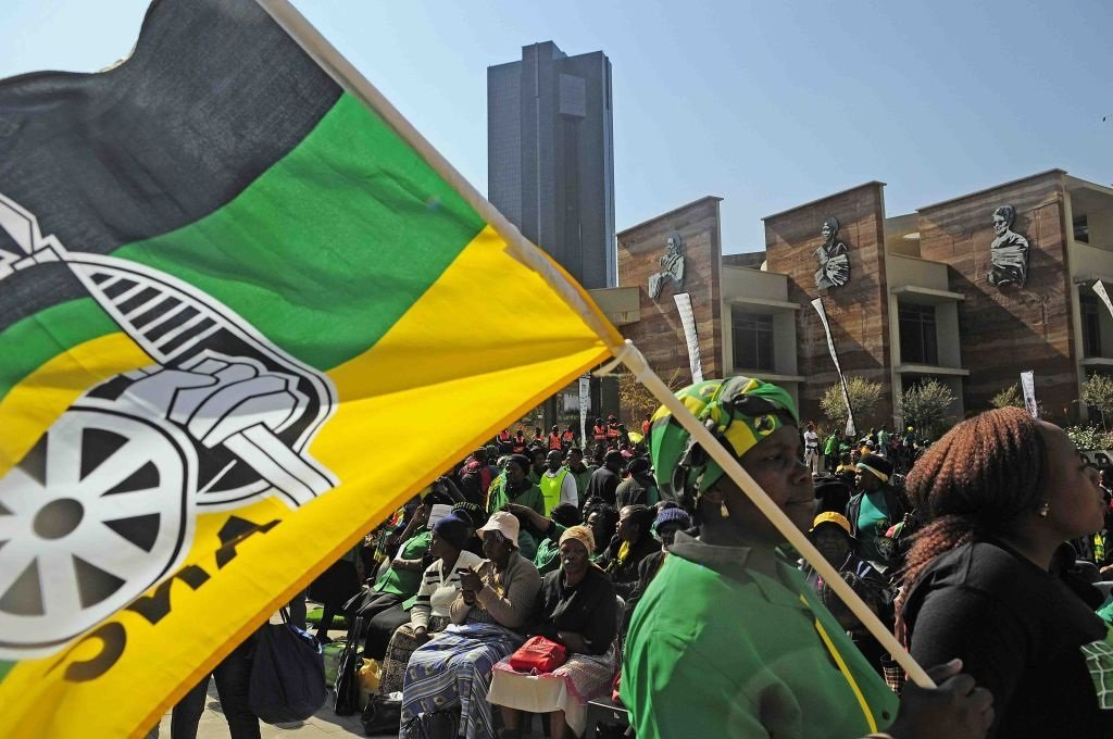 ANC members wave the party's flag.