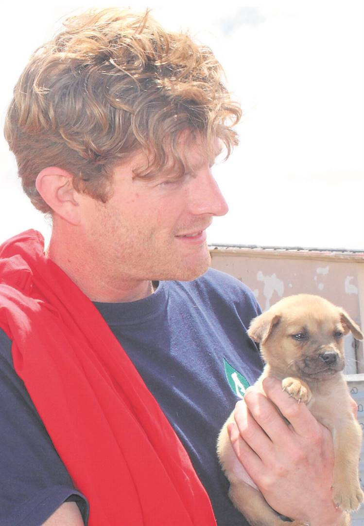 Luke Kruyt with a puppy in need of vaccinations from Hillview.PHOTO: Racine Edwardes