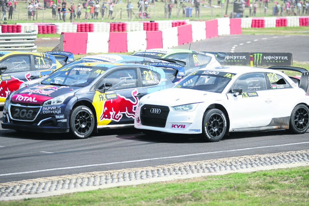 Kevin Hansen (left), Timmy Hansen and Krisztian Szabo all jockey for the lead at the start of their Q3 race at the World Rallycross Championship at Killarney on Sunday 10 November. Timmy Hansen would eventually win the roundPHOTO: Rashied Isaacs