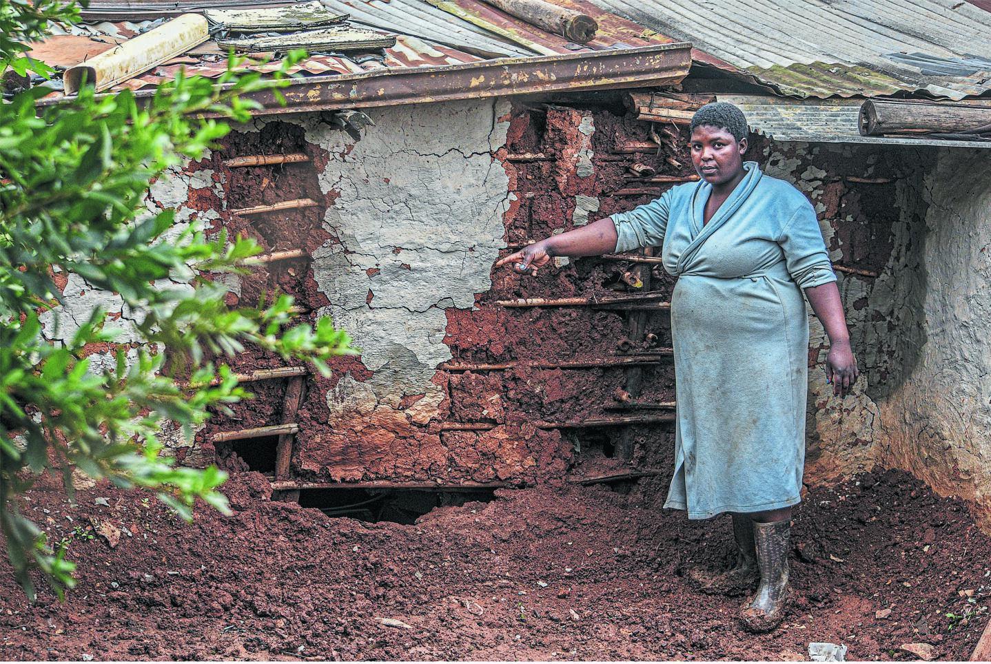 Nomazizi Mtebeni from Nhlalakahle points to where her house was badly damaged during the heavy rains on Sunday. PHOTO: Moeketsi Mamane