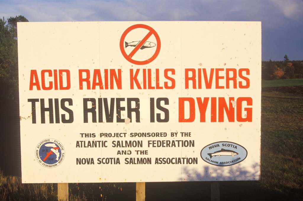 A sign warning this river is dying (Photo by: Joe