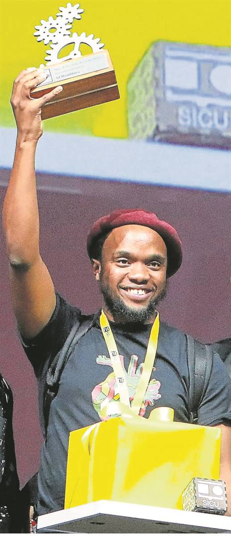 Mbangiso Mabaso, developer of the SI Realities app, raises the award for best innovative solution presented to him at the MTN Business App of the Year Awards ceremony. Photo: Supplied
