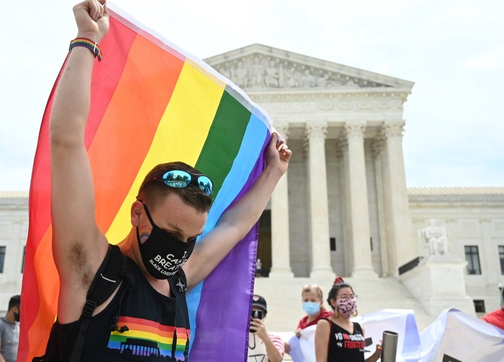 A man waves a rainbow flag in front of the US Supreme Court that released a decision that says federal law protects LGBTQ workers from discrimination. (File)