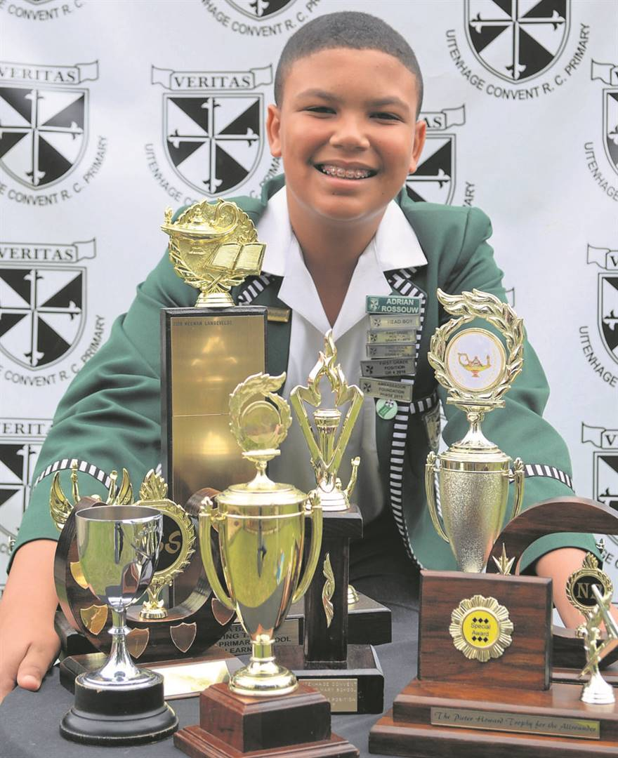 LEFT: Adrian Rossouw was nominated as Uitenhage Convent Roman Catholic Primary's Dux learner of 2019. He received trophies for the best Grade 7 learner in English, Afrikaans, Mathematics, Natural Sciences, Social Sciences and Economic Management Sciences. Other trophies received were as follows: A'isha Bailey trophy for Dux Learner; Hodgkiss trophy for Deportment & Good Fellowship; Peter Howard trophy for Best All Rounder; trophy for First Grade Position. Adrian will commence with his high school career in 2020 at Muir College.