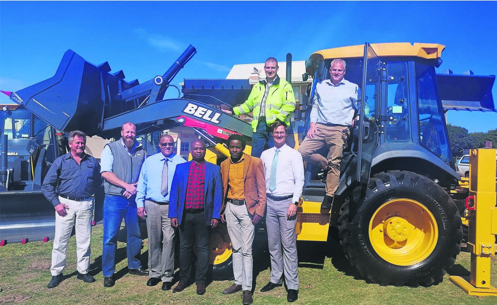 At the delivery of the new TLBs were (front from left) Gert Nelson, Tom Swartz, Kouga Community Services Portfolio Councillor Daniel Benson, Ntsikelelo April, Sokhana Ngcaku, Kouga Speaker Hattingh Bornman, (back) Daniel van der Walt and Kouga Infrastructure and Engineering Director Victor Felton.        Photo:SUPPLIED