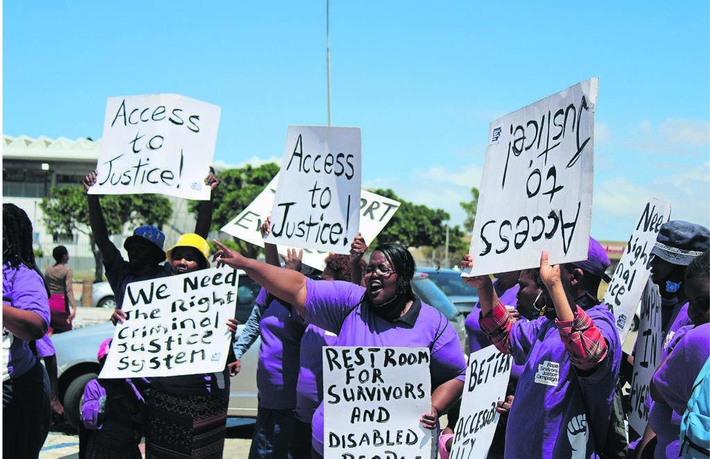 Rape Survivors Justice Campaign members picket in front of Khayelitsha Magistrates' Court. PHOTO: mzwanele mkalipi