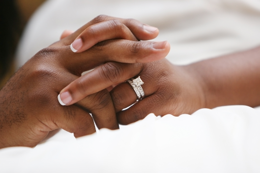 Clasped Hands of Bride and Groom. Photographer: Jessicaphoto