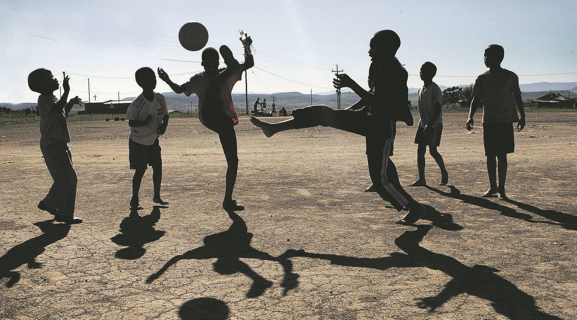 Boys play soccer in the rural village of Ladysmith, where there are no recreational facilities. Picture:                                                                                            Khaya Ngwenya