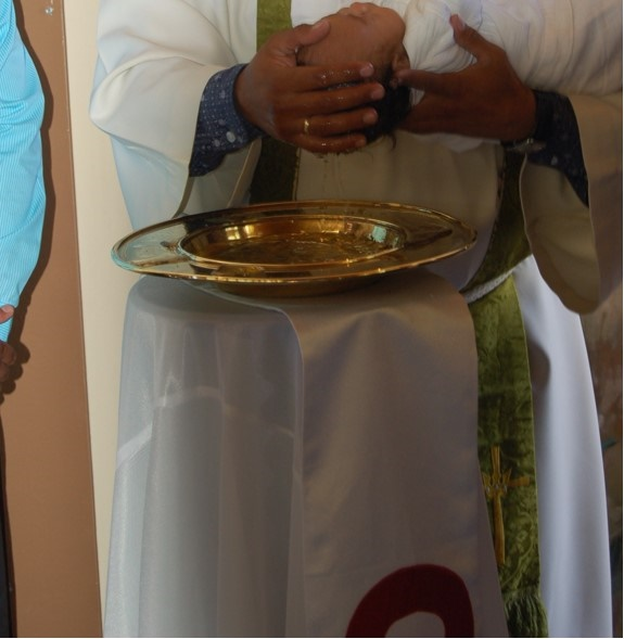 The brass baptism bowl stolen from the Evangelical