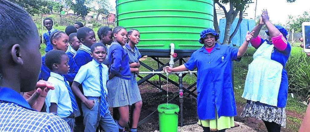 Parents and pupils at the official handover of the bore-hole.PHOTO: supplied