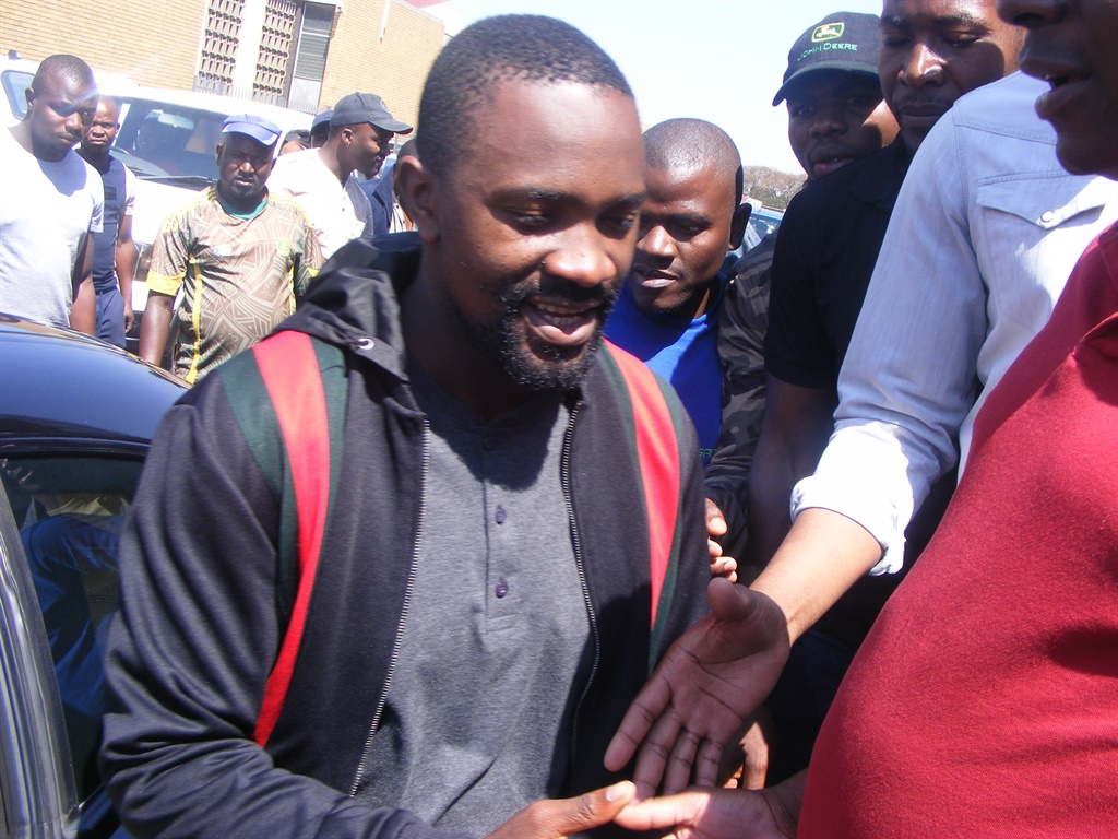 Businessman Sam Chabalala greets people outside the Witbank Magistrate's Court in Mpumalanga, in September. (Balise Mabona, News24)