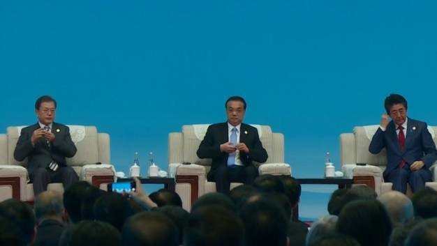 China hosts leaders from Japan and South Korea. (Screen grab, AFP)