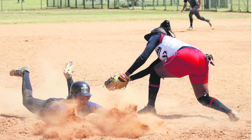 A diving Lynn Lakay of Glenthorn A's (left) beats the run out attempt of Kenfac Phillies' third base fielder Casandra Kalpens during a Super League game played at Turfhall sport complex on Sunday 24 November. Glenthorn won 8-7 in a high-paced game. PHOTO: Rashied Isaacs