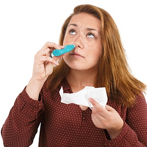 Woman with nasal congestion