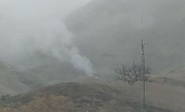 Smoke from a military helicopter crash, captured from a distance.