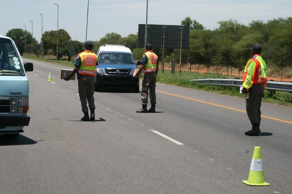 Tshwane Metro Police Department officers stopping motorists.