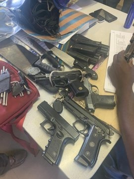 Guns confiscated from five suspects, including two JMPD officers and SAPS policeman. (Supplied)