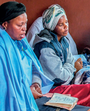 Xolisile Dladla Mpungose mourns with family members in her Durban home (PHOTO: Move!)