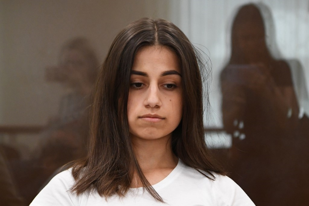 Angelina Khachaturyan, one of three teenage sisters accused of murdering their father, attends a hearing at a court in Moscow. (Yuri Kadobnov/AFP).