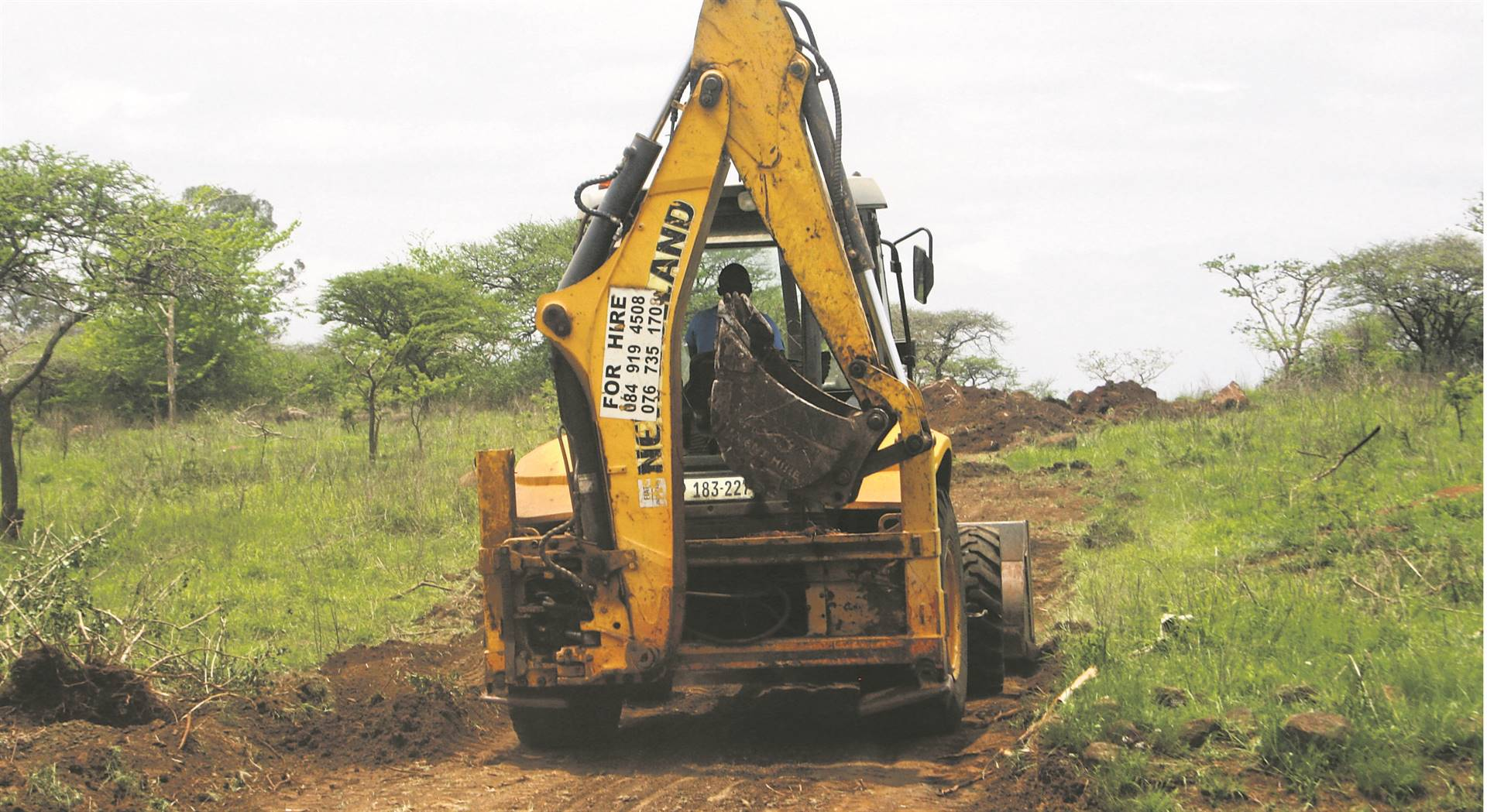 The land invaders use graders to erect illegal structures.