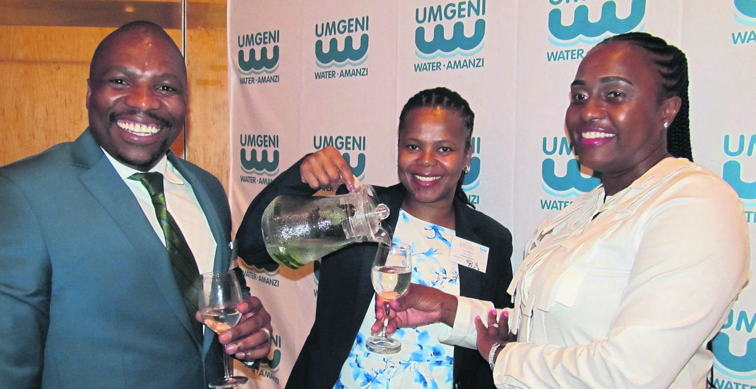 Umgeni Water's chief executive Thami Hlongwa, chief financial officer Lungi Mkhize (centre) and chair of the board Ziphozethu Mathenjwa toasting to another successful year for the water utility.PHOTO: NOKUTHULA NTULI