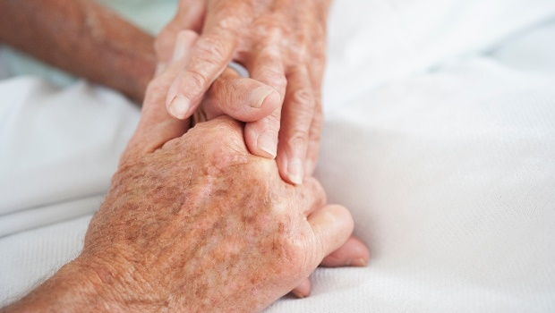 Elderly couple holds hands. (Photo: Getty Images)