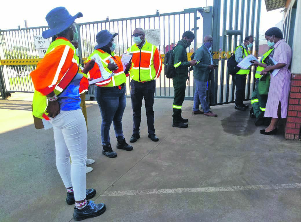 Labour department inspectors assessing the level of compliance by Pietermaritzburg businesses yesterday.