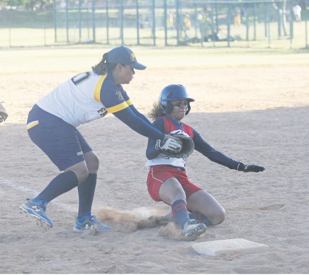 Bettina Phillips of Falcons stops Kenfac Phillies player Jenna Moses in her tracks with a tag on third base during a Super League game played at Turfhall on Saturday 7 December.       PHOTO: Rashied Isaacs