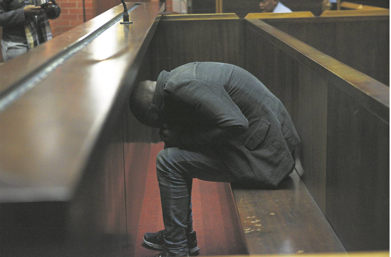 Msizi Mbotho tried his best to avoid being photographed yesterday in the Pietermaritzburg high court where he was sentenced to life imprisonment. He killed DUT student Sandile Ndhlovu at the Berea Campus.Msizi Mbotho tried his best to avoid being photographed yesterday in the Pietermaritzburg high court where he was sentenced to life imprisonment for killing DUT student Sandile Ndhlovu. PHOTO: Moeketsi Mamane