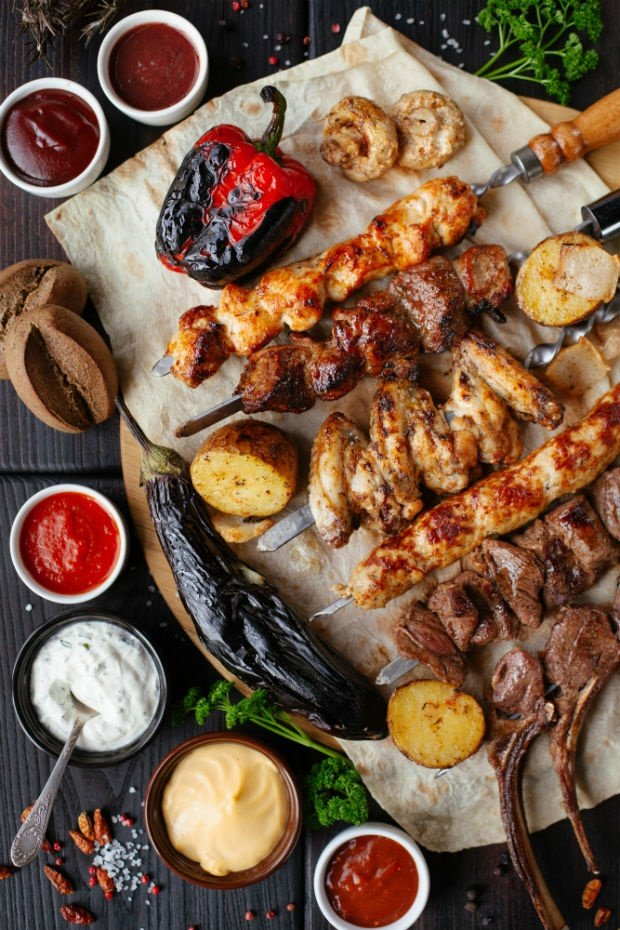 kebabs and braai meat with sauces