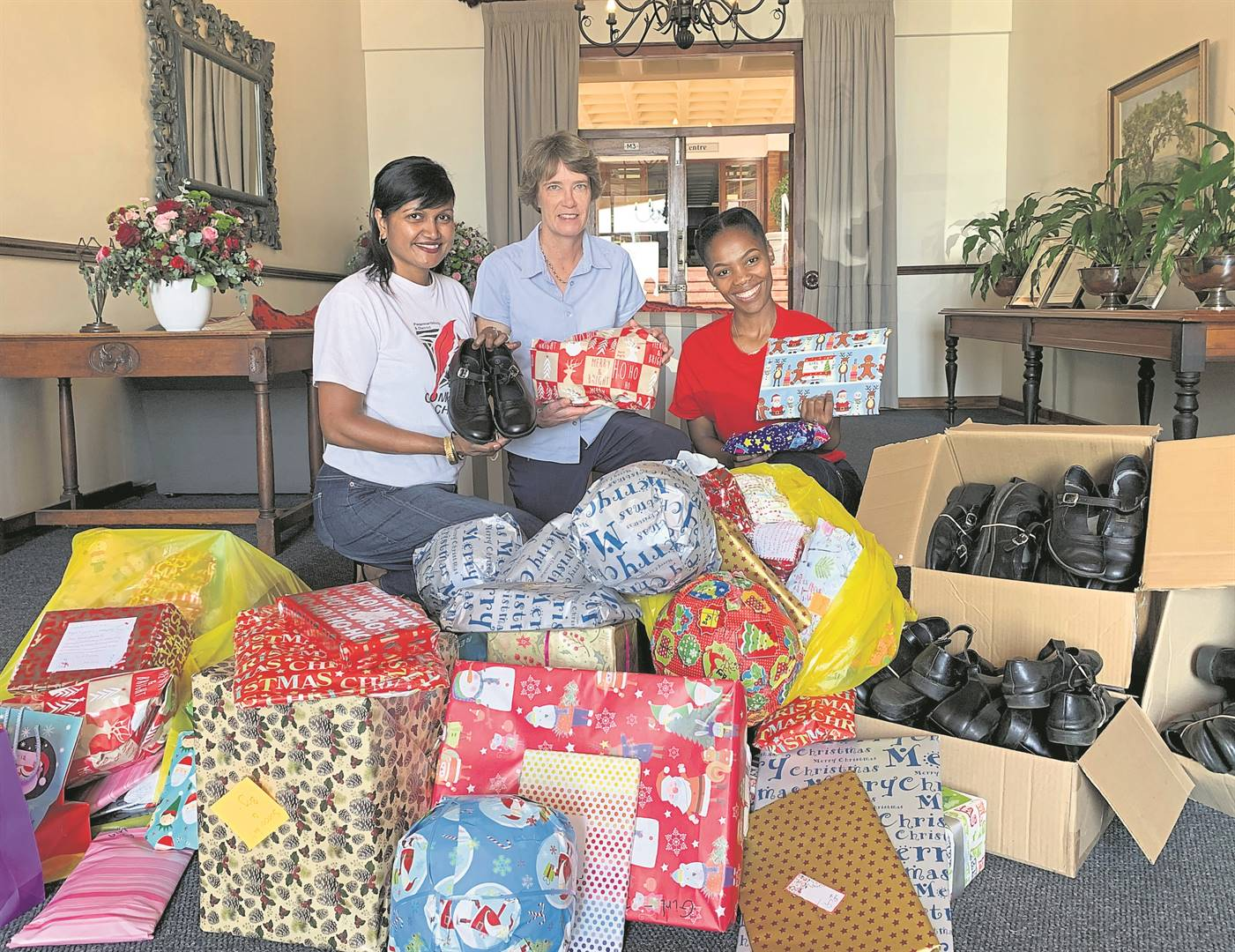 The Wykeham Collegiate girls donated gifts and school shoes to the Community Chest. Angie Narayanan and Lindokuhle Ngubane from Community Chest collected them from the Lady principal, Sue Tasker, to distribute to the less fortunate.PHOTO: supplied