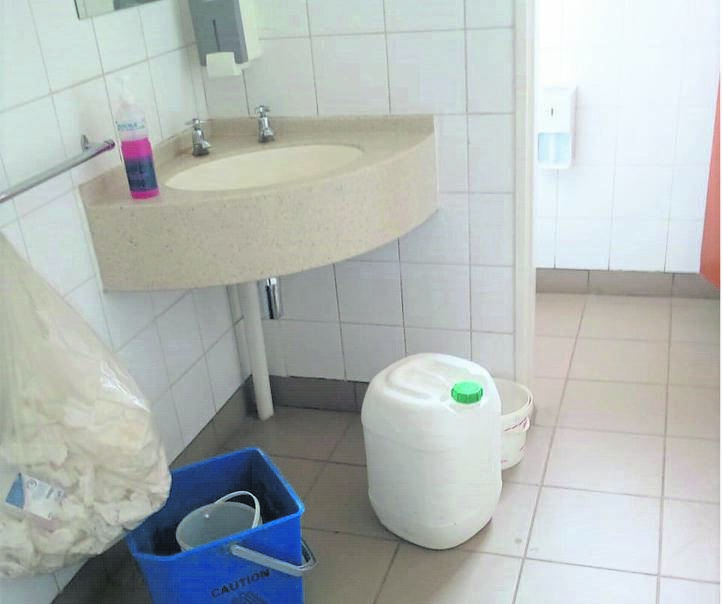 An empty 20 litre container which staff used to fetch water, inside one of the consultation rooms at the Bophelong Clinic.