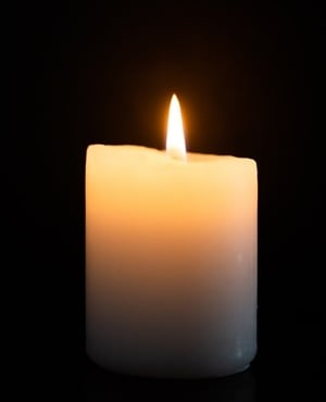 Candle with a flame illustrating loadshedding or candle light. (Photo by Gallo Images/Misha Jordaan)