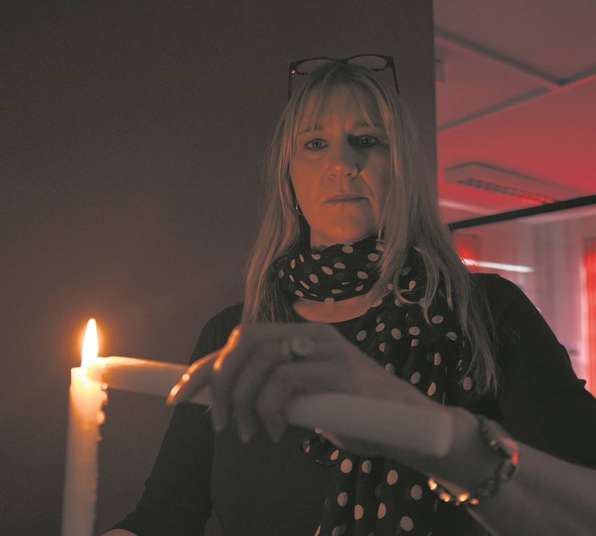 PHOTO: suppliedPietermaritzburg and Midlands Chamber of Business CEO, Melanie Veness, holds up candles during a period of load shedding at the chamber's offices.Photo.Moeketsi Mamane