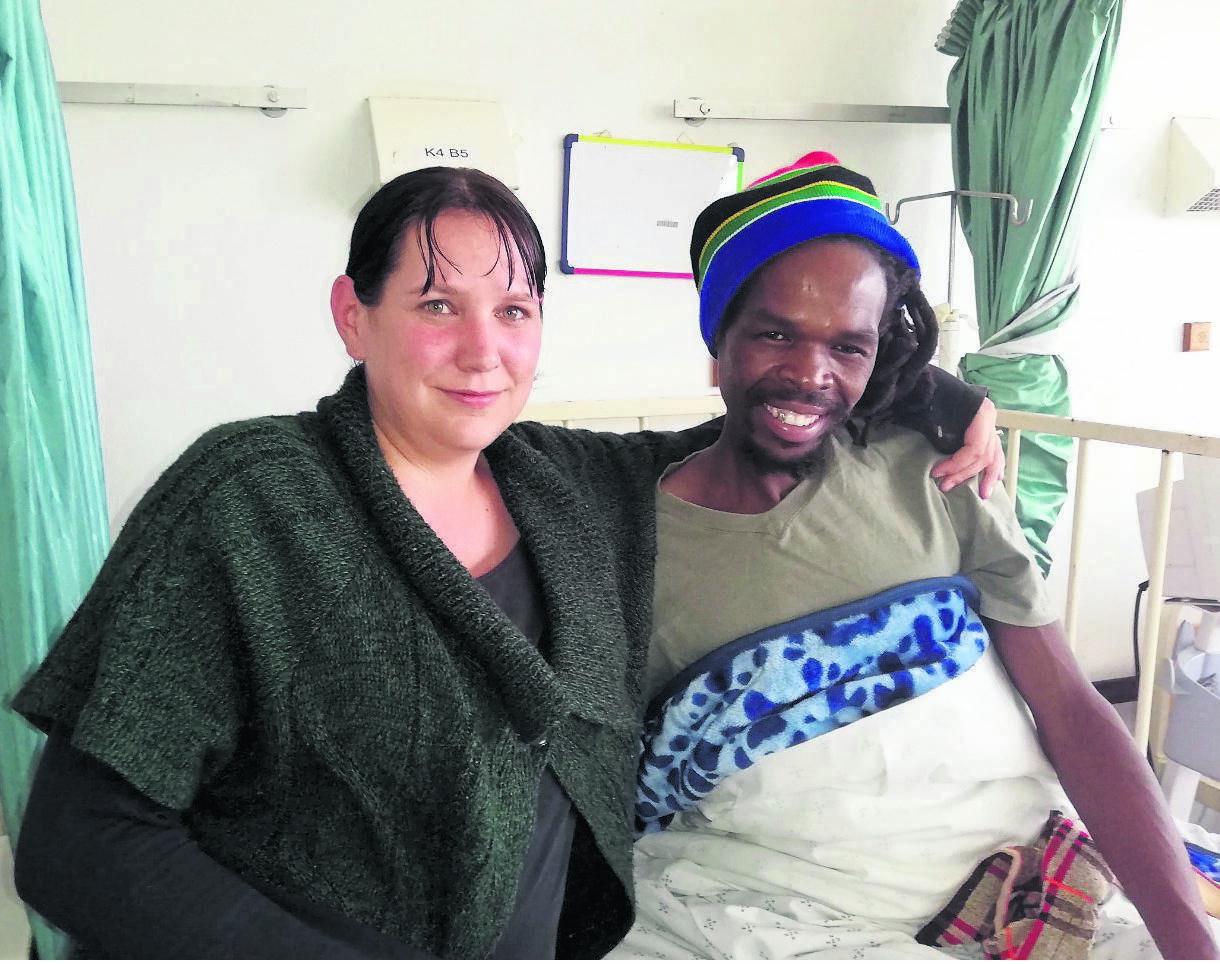 Thandi Home orphanage owner Rene Morcom with Jika Joe fire victim Zamani Mbanjwa.