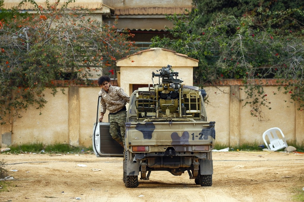A fighter loyal to the internationally recognised Libyan Government of National Accord (GNA) exits a vehicle in an area south of the Libyan capital Tripoli. (Mahmud Turkia/AFP).