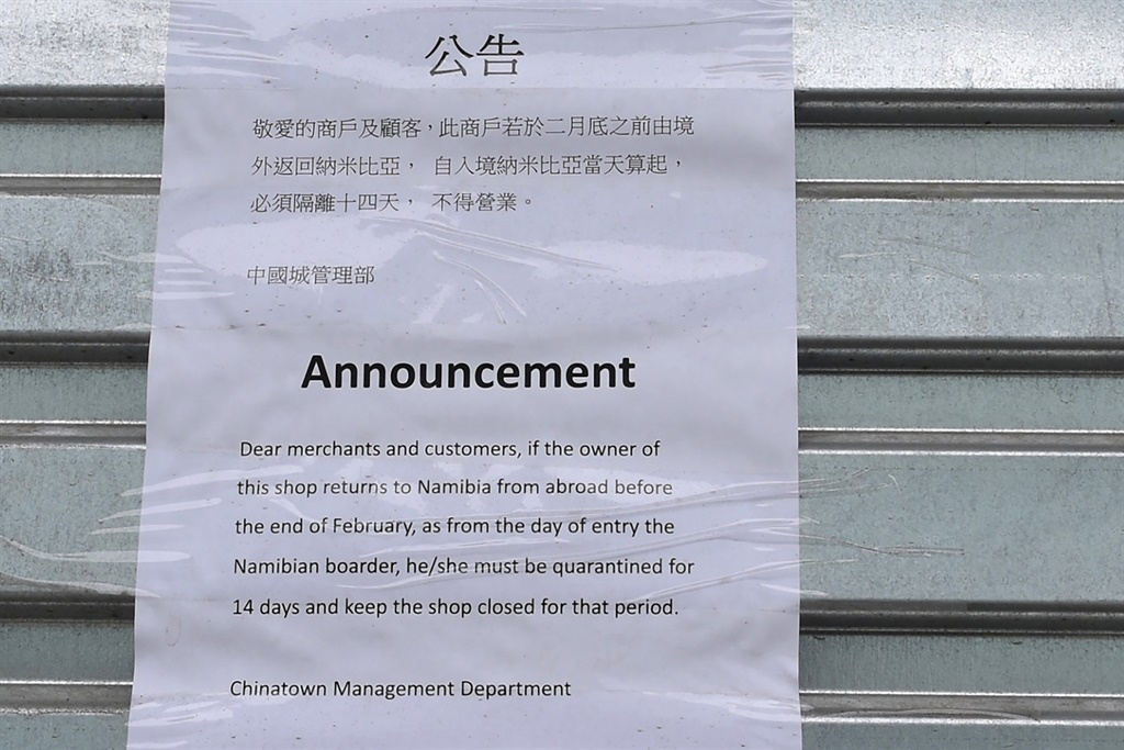 A letter to customers by the Chinatown Management Department attached on the shutters of a closed shop in the Chinatown area informs that if the owner of the shop returns from abroad, the person must be quarantined for 14 days and the shop closed for that period, in Windhoek, Namibia, on February 15, 2020. Despite there being no confirmed cases of the novel coronavirus in Namibia, its effects have been nevertheless felt in the Chinese business community based in Windhoek.