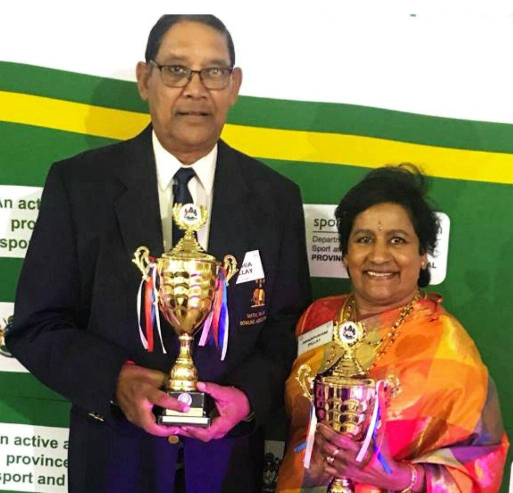 """Warrant Officer Nithia """"VN-Lucy"""" Pillay with his wife, Aarthi, with awards from the Sports Veterans' Association.PHOTO: SUPPLIED"""