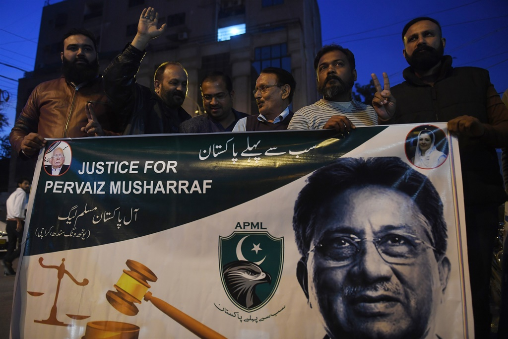 Supporters of the All Pakistan Muslim League, the party of former military ruler Pervez Musharraf, shout slogans take part in a protest after a special court's verdict, in Karachi. (AFP)
