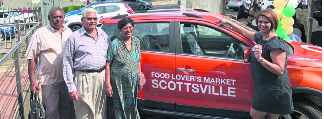 Doll Maistry (right) with her family after winning a car. PHOTO: supplied