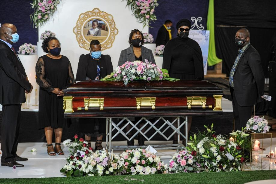 Limpopo Education MEC Polly Boshielo, MEC for Social Developmen in the Limpopo legislature Nkakareng Rakgoale and other government officials surrounding Lufuno Mavhunga's coffin during her funeral at the Spirit Ambassador International Church in Thoyondou, Limpopo Limpopo. Picture: Rosetta Msimango/City Press