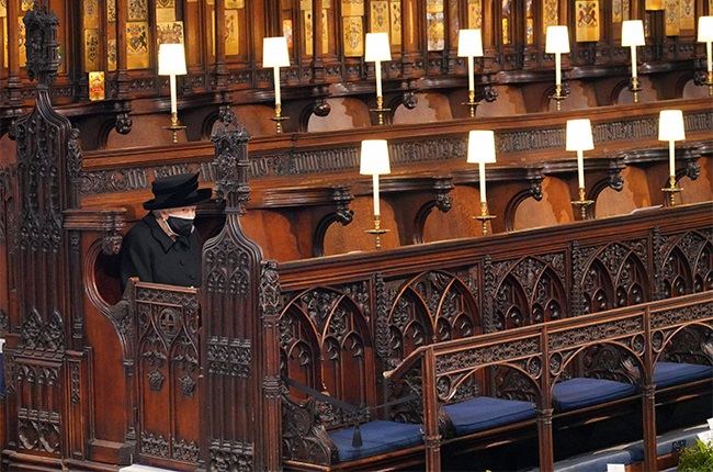 Queen Elizabeth takes her seat as she waits for the funeral service of her husband, Prince Philip, to begin.