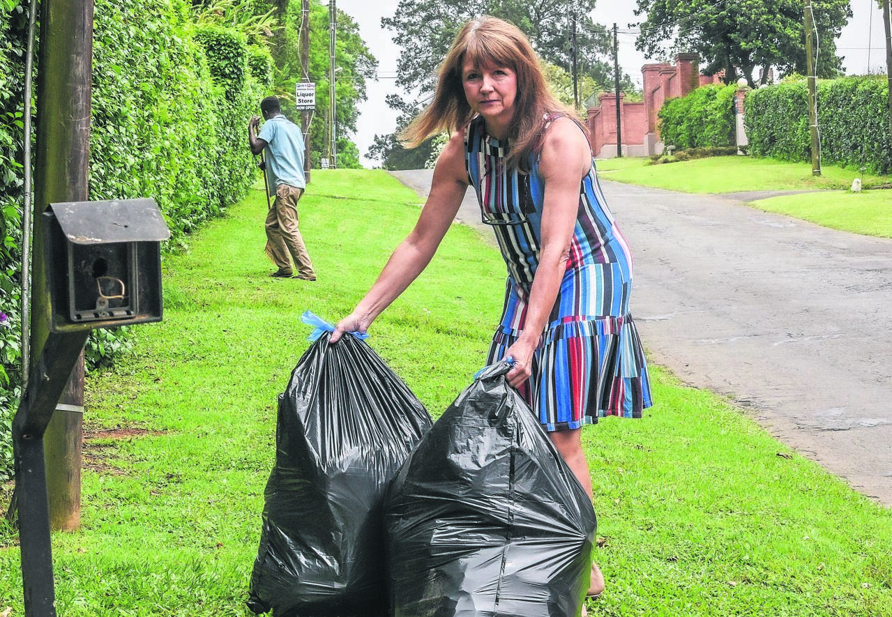 Athlone woman Aletta Wegener stands with her rubbish which still hasn't been collected because garbage collectors demanded a Christmas present to work. PHOTO: Moeketsi Mamane